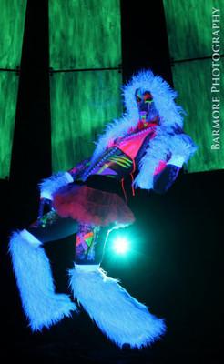 Pink Fur Flared Leg Warmers glowing under blacklights!