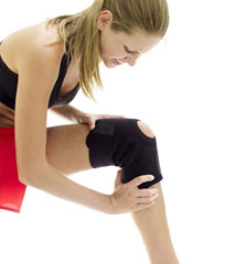Photo of a woman with a knee brace