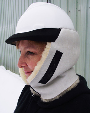 Sheepskin head warmer attaches to hard hat for hands free and stationary warmth.