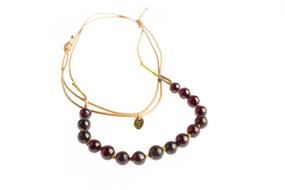 Asha Patel's Garnet Leather Necklace