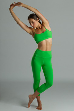 Green yoga outfit with yoga capris leggings and yoga bra tops