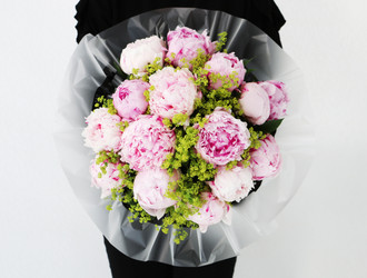 A luxurious bouquet of fifteen cloud like Pink Peonies and Alchemilla Mollis foliage.