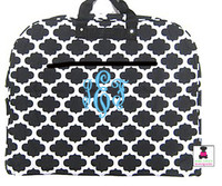 monogrammed garment bag in black and white quatrefoil
