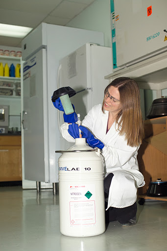 sarah-pulling-vial-out-of-dewar-vertical.jpg