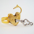 Gold padlock ring really opens and closes.  Comes with non-working key