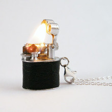 Vintage Lighter Necklace really works!  These are totally cool gadgets you can wear, the hottest functional jewelry around.