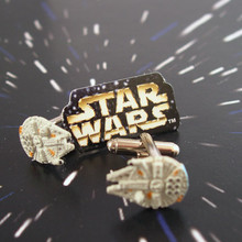 Go to hyperdrive with these Authentic Star Wars mini Millennium Falcons on your sleeve.