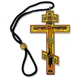 The cross ornament we have available has a slightly different icon then that pictured in our catalog.