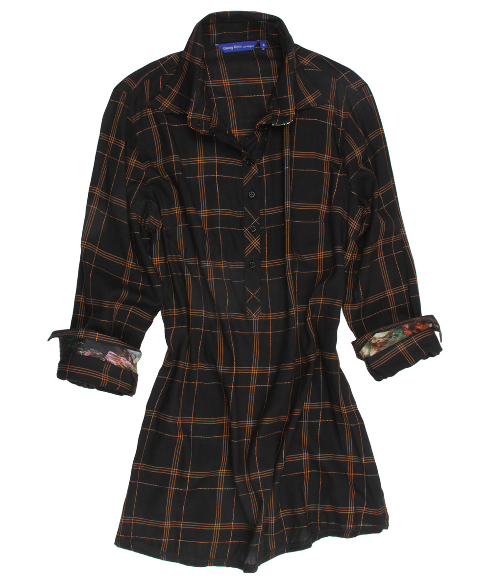 Dramatic and alluring is our luscious plaid tunic.  The copper lurex on the black ground gives way to just enough shimmer to be sophisticatedly exciting and ultra flattering.  The cuffs, if you care to roll them, have a small print to add originality to this outstanding look.  But is doesn't stop there!  The underneath collar is embellished with our band of small sequins in the copper, rust and hunter green tones.  As always, the hem is our double zig-zag stitching for that finished and complete high style tunic.  55% Cotton/ 44% Viscose/ 1% Poly Imported European fabric