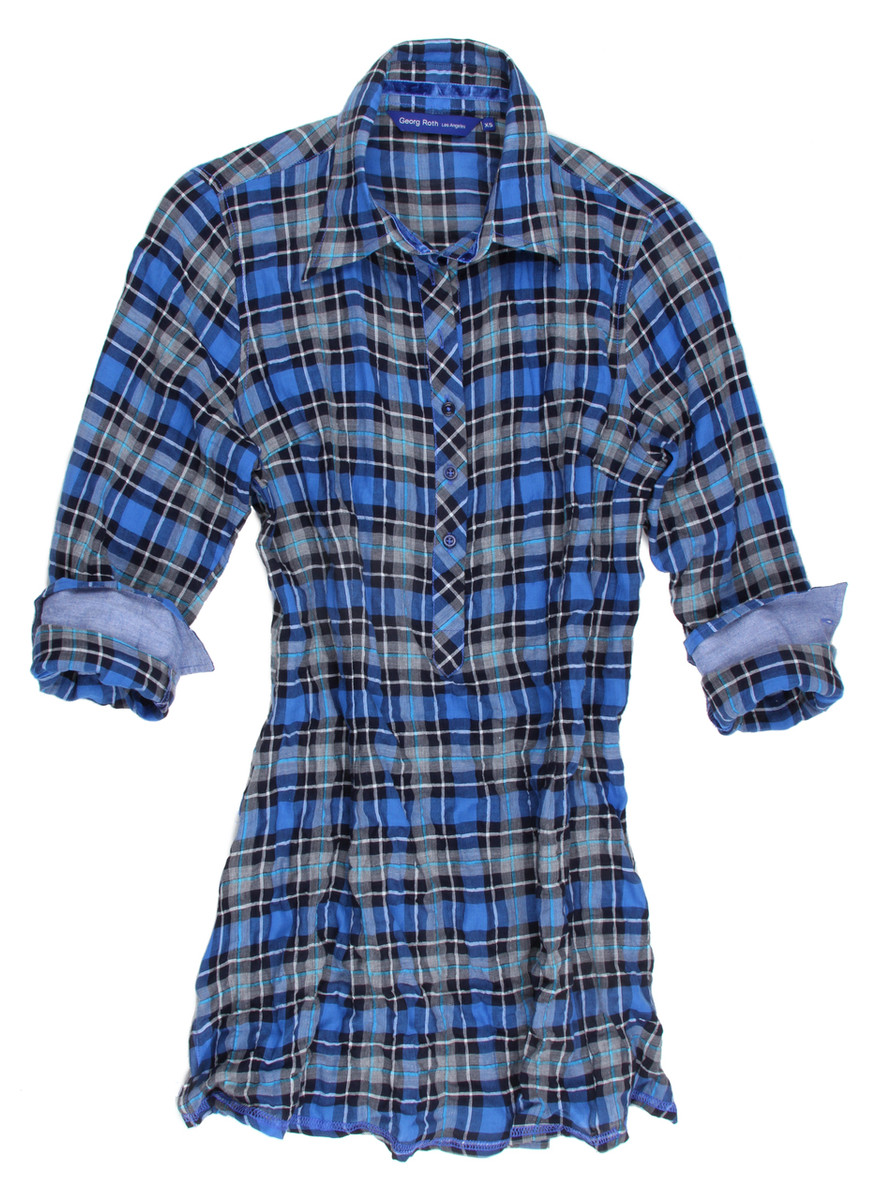 A flattering shape, a dramatic plaid and flirty details combine for a day-to-night look that complements every shape. The vibrant Georg Roth Los Angeles long sleeve plaid tunic in tones of royal blue, black & off-white is detailed with a blue oxford contrast on the outer collar stand and cuffs. Finishing touches of a royal blue crushed velvet ribbon inside the collar stand and inside front placket. All seams are done to perfection with contrast stitching in royal blue. 99% Cotton, 1% Spandex