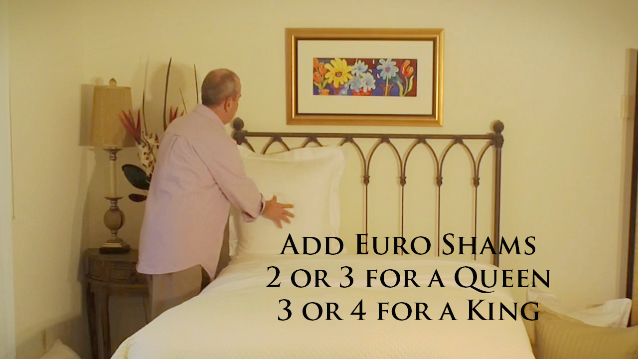 Add Euro Shams to the head of the bed