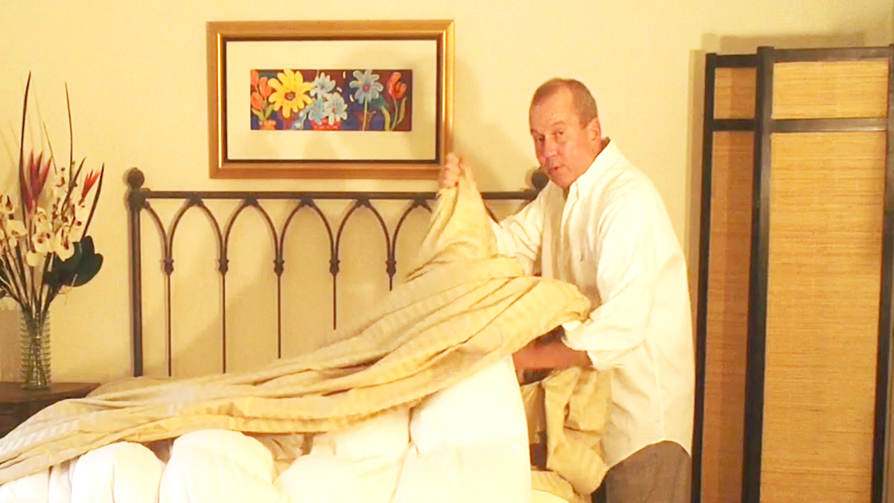 Feed the down comforter up the inside of the duvet cover