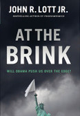 At The Brink Autographed by John R. Lott Jr.