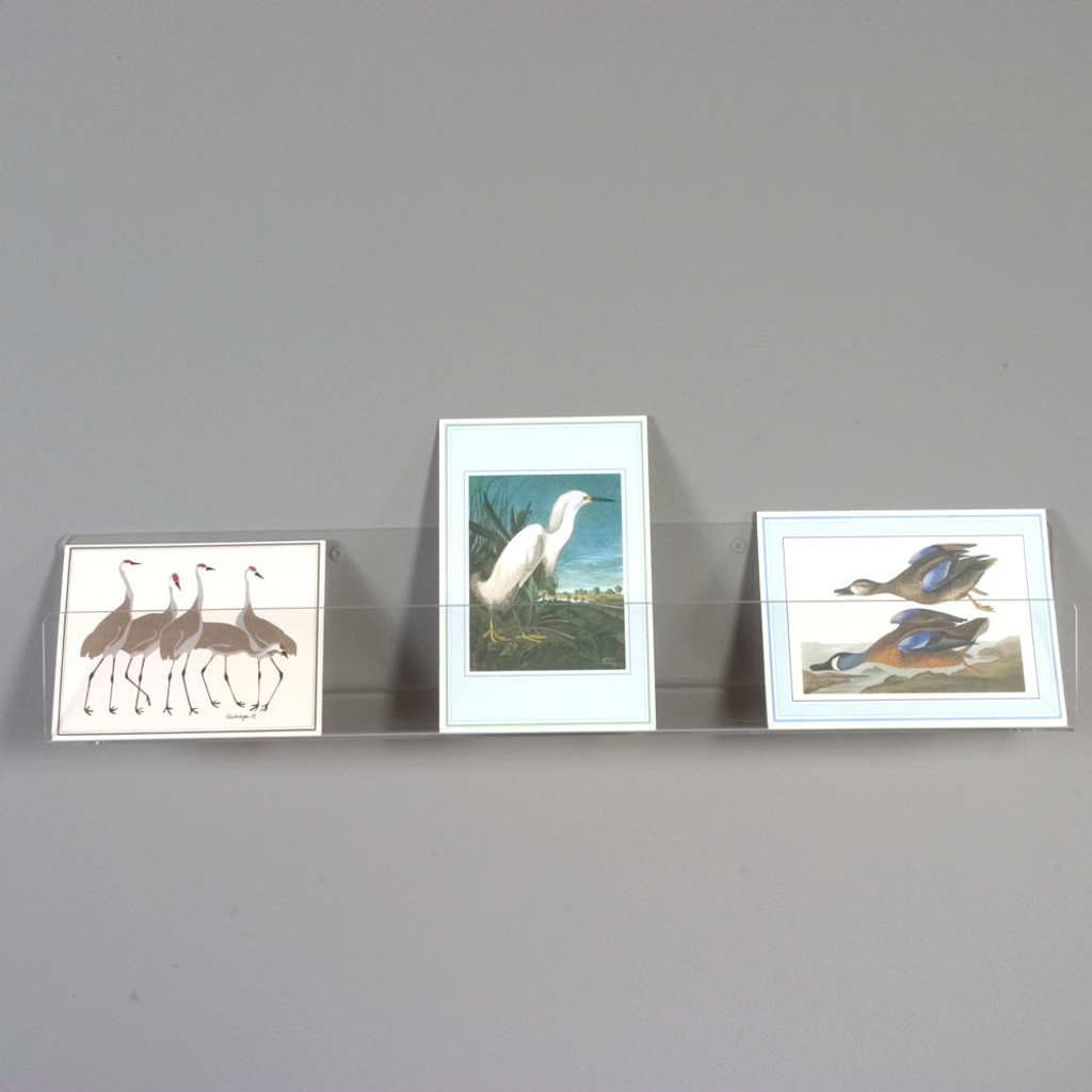 These shelves are perfect for displaying greeting cards. The angled base of the shelf makes the bottom of the cards come to the front and tilt back for best viewing angle. 8020