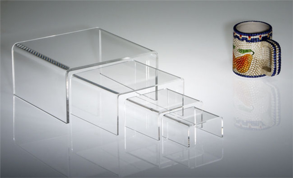 Clear acrylic half-height rectangular risers in multiple sizes, a versatile option for retail display.
