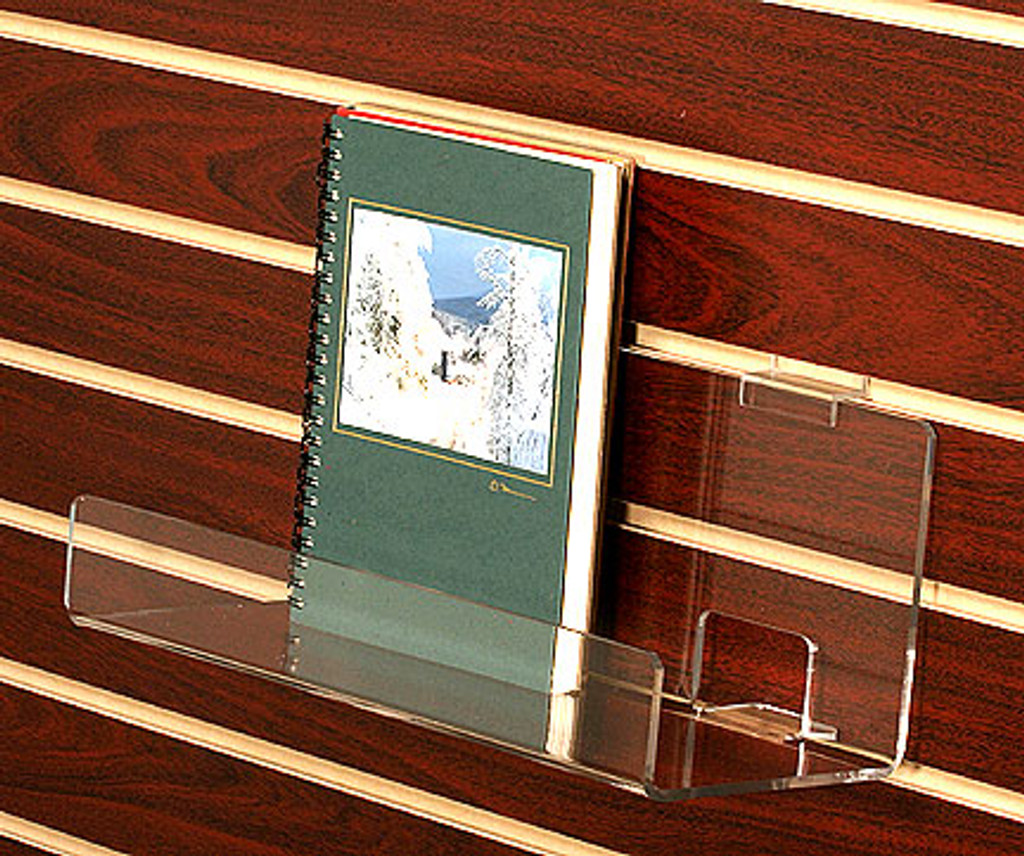 Clear acrylic slatwall shelf for boxed notecards, CDs, DVDs, books.