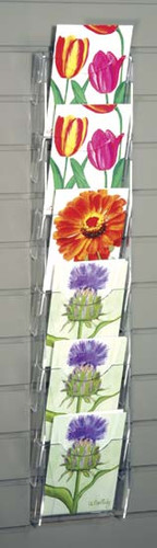 Clear acrylic slatwall mounted postcard/ greeting card rack with six pockets.
