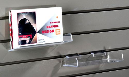 Clear acrylic shelf for slatwall.