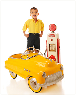 Child With Yellow Pedal Car