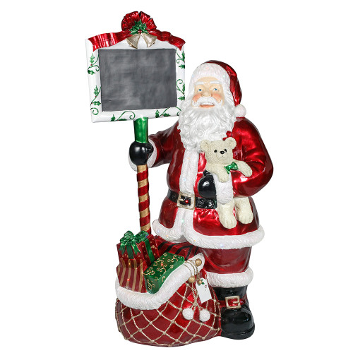 Santa Claus with presents and blackboard