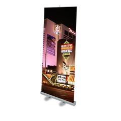Custom graphic banner stand display showing night life.