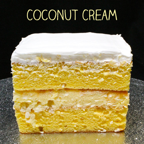 Moist yellow cake + French vanilla custard + shredded coconut + Lisa's signature Italian whipped cream.