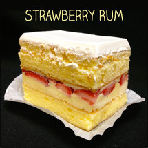 Moist yellow cake layers filled with (non-alcoholic) rum custard and fresh strawberry slices frosted in Lisa's signature Italian whipped cream.