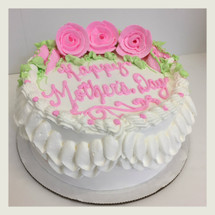 Double ruffle border with pink frosting roses.