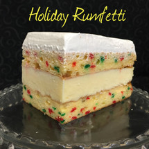 Moist yellow cake baked with red & green confetti + (non-alcoholic) rum custard + Italian whipped cream.