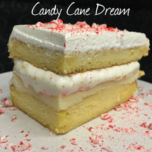 Moist yellow cake baked filled with creamy French Vanilla custard & peppermint fluff (marshmallow) from Fluff It Gourmet Marshmallows + Italian whipped cream. The perfect balance of vanilla & peppermint. Crushed candy cane included.