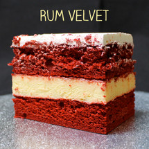 Cream cheese-less... Southern Red Velvet cake + signature Rum custard + Lisa's signature Italian whipped cream frosting.