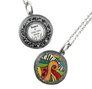 This pendant features the artistƒ??s rendering of an abstract painting on one side and the words: ƒ??Dance to your own music.ƒ?