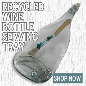 These recycled wine bottle serving trays are an eco-friendly way of serving cheeses and other foods at your next party.