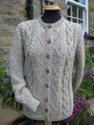 Ladies Aran Cardigan Hand Knitted in natural Swaledale Aran weight wool with wood buttons