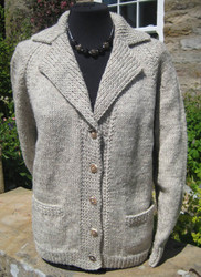 Ladies Hand-knitted cardigan in natural light grey Welsh wool with wood buttons.