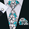 White with brown and turquoise blue floral pattern necktie set.