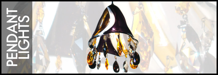 Swarovski crystal hangs from the lip of these hand blown glass pendant lights