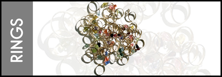 rings that have a hanging and dangling crystal drop attached with fine metal.
