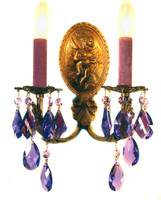 A pair of antique brass sconces draped with purple STRASS crystal