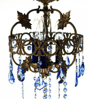 Crown shaped antique brass chandelier draped in rich blue STRASS Swarovski crystal