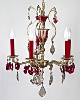 karen curtis' Golden teak and Bordeaux STRASS crystal draped from a antique Spanish chandelier with red inlay