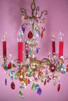 Ornate antique chandelier with both hand cut glass and brass components. Draped with many different colored STRASS crystals