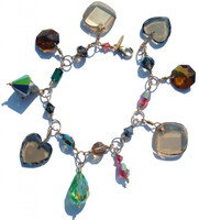 Swarovski crystal charm bracelet with rare and discontinued elements on gold filled and limited edition