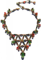 This is a larger version of the popular v-necklace with a more spacious effect.  All designed on gold filled metal and adjustable to desired length on your neck.  Packed full of vintage and discontinued SWAROVSKI ELEMENTS. The main colors include Peridot, Special Effects, Salmon, Golden Shadow and Green Tourmaline.