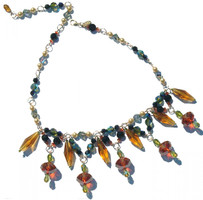 One of a kind chunky Swarovski crystal necklace.  Beautiful and unusual large shapes and colored Swarovski elements.  Made on gold filled metal, colors include topaz,burnt orange,lime,light azure blue, navy, and champagne colored pearl elements