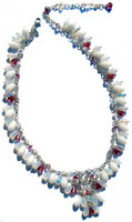 Swarovski crystal v-necklace is a karen curtis original design. Metal is all sterling silver and Swarovski elements hang all the way around the necklace. Colors include white,fushcia,sand and turquoise. This necklace is limited edition