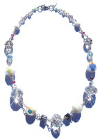 Chunky single strand necklace made entirely of sterling silver and different colored Swarovski elements. Tapered design starts with smaller crystals in the back as crystals get larger in the front.