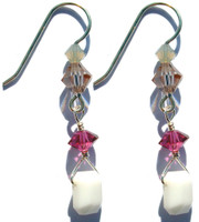 Very rare Swarovski elements, emerald shaped chalk white crystal from the 1930's hangs from sterling silver earring, accented by fuchsia,sand and champagne colored crystals