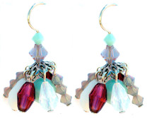 Cluster earrings with 8 Swarovski crystals on each earring. Umbrella like design with fuchsia,white opal,sand and turquoise colors. Sterling silver