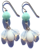 Swarovski crystal triple drop earrings on sterling silver metal with French wire.  Rare chalk white Swarovski element with white opal and turquoise.